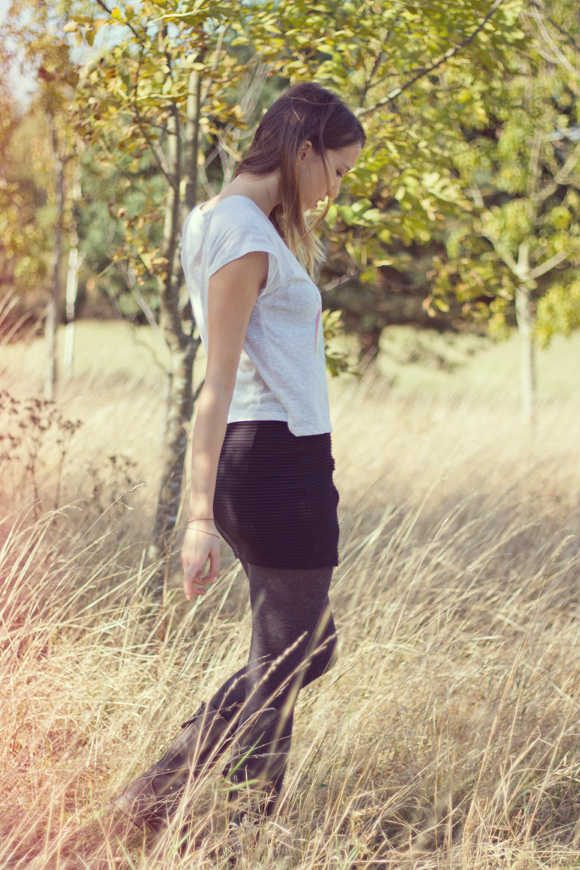 Rock t shirt, black body con zipped skirt and lace up boots