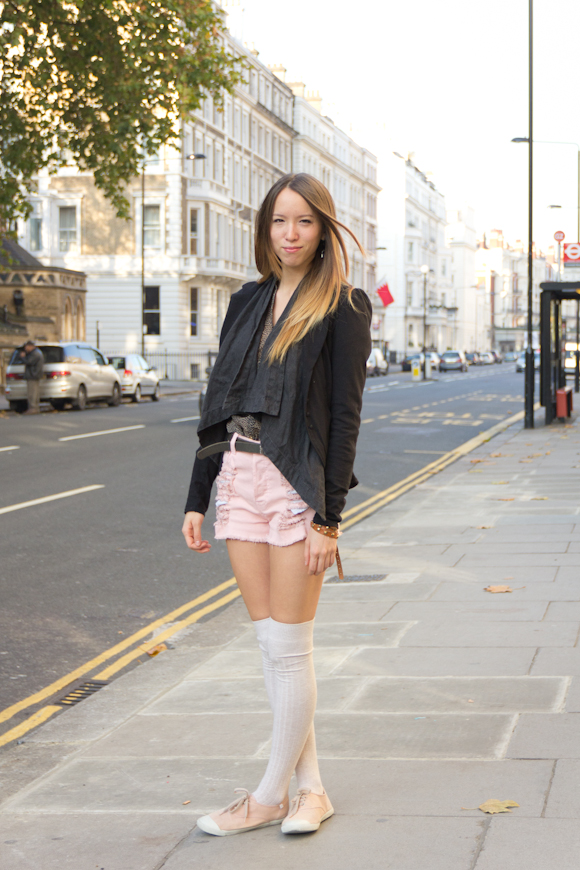 Pink shorts, socks and plimsoles